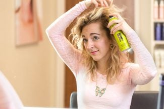 Nicole shows how to use dry shampoo