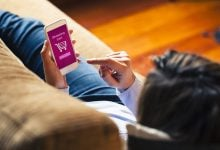 girl shopping on her cell phone: what do your shopping habits say about you?