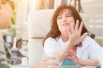 Woman using her hands to talk about her Energy Type