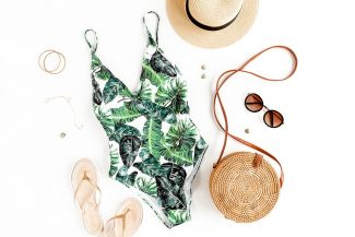 Flat lay of swimsuit and summer accessories