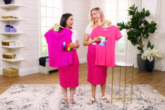 Kalista and Jaleah each holding pink clothes in their Type