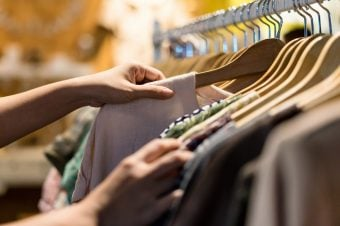 Woman shopping for clothes on a rack at the store