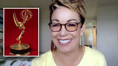 Carol smiling with an Emmy