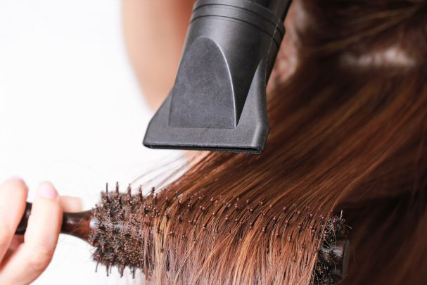 image of hair being round brushed and blown dry