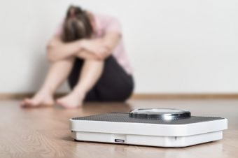 How each Type of woman shames her body - woman feeling ashamed next to a scale