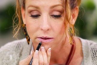 Women applies lip liner