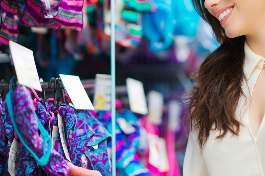 Woman browsing swimsuits - 5 tips to get the best swimsuit of your life