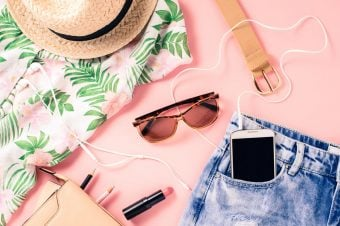 Summer capsule wardrobe checklist - sunglasses, floral shirt, jean shorts