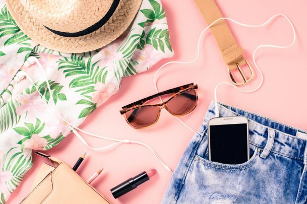 Summer capsule wardrobe checklist - sunglasses, floral shirt, jean shorts