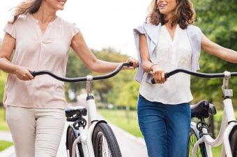 Two women riding bikes - Type 2 lifestyle tips