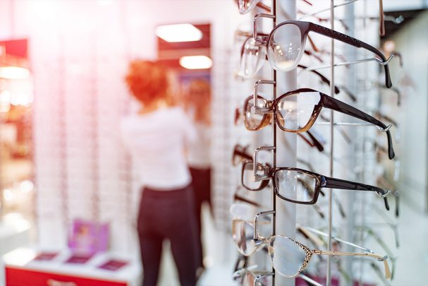 Woman choosing eyewear in a store
