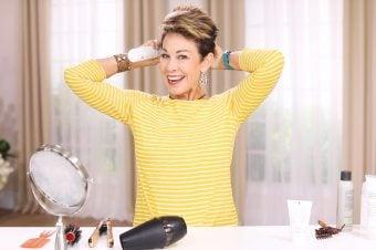 Woman styling short hair