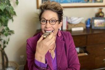 Carol sharing weight loss tips while holding a cupcake