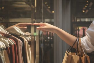 Woman shopping for clothes as she develops her personal style
