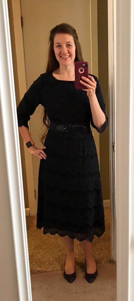 Woman wearing navy lace dress to funeral instead of black