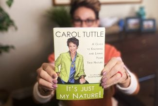 Carol Tuttle holding her book It's Just My Nature