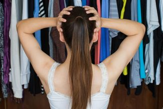 Woman standing in front of her closet - is Dressing Your Truth not working for you?