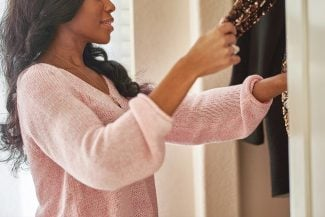Woman looking in her closet - 4 tips to determine your secondary Energy Type