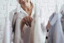 Woman choosing items of clothes - 10 things women over 50 should not wear