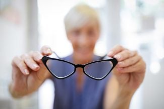 Woman holding up glasses