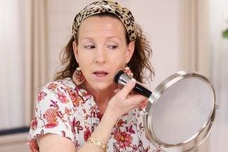 Anne K applying makeup foundation